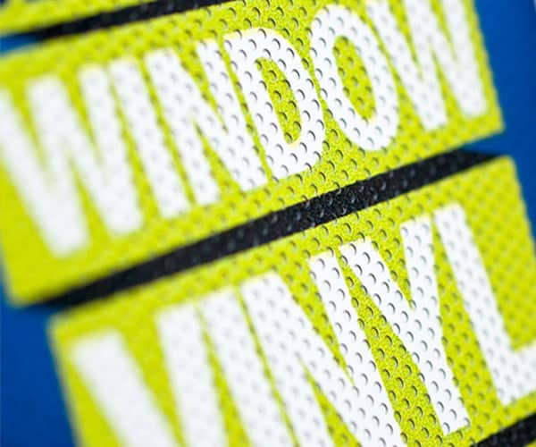 Perforated window vinyl decal in blue and green