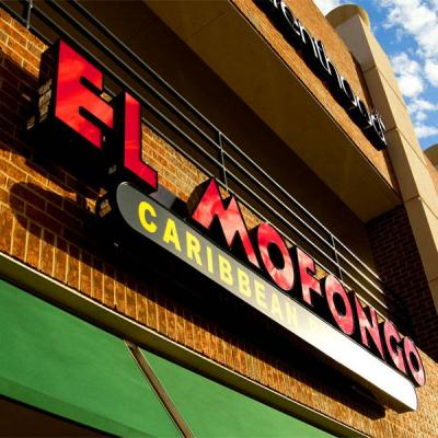Front lit channel letters (in red) and cabinet sign (yellow letters on a black background) for Mofongo Caribbean Restaurant