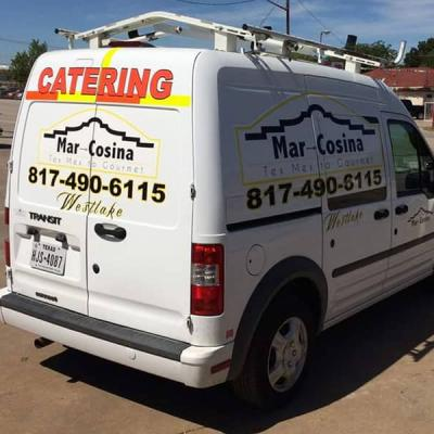 White van branded using a partial wrap. Design  includes Mar-Cocina Catering logo, phone and location.