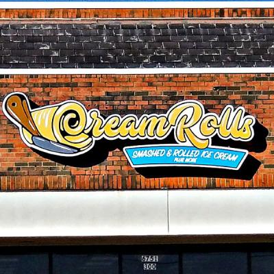 Cabinet sign with Cream Rolls Ice Cream logo